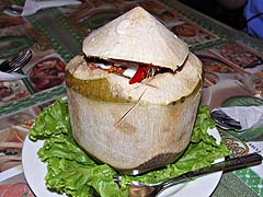 Seafood curry in a young coconut